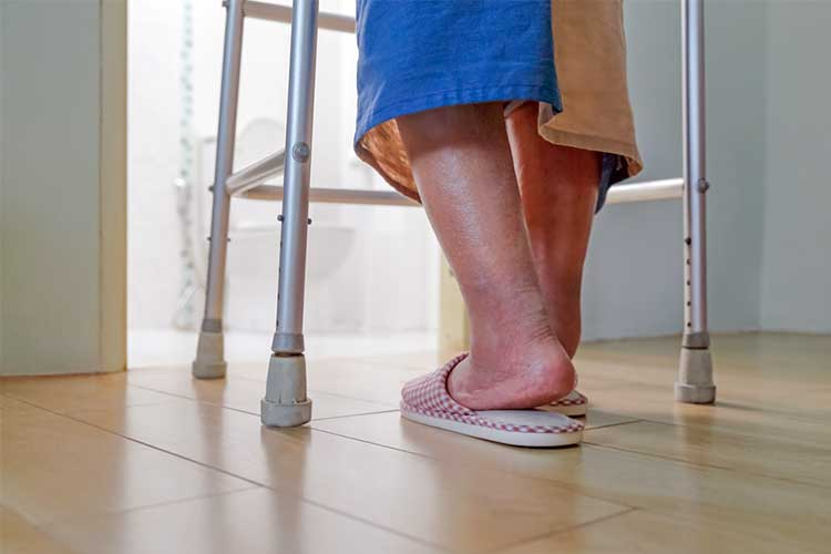Elderly patient using walking frame | Image