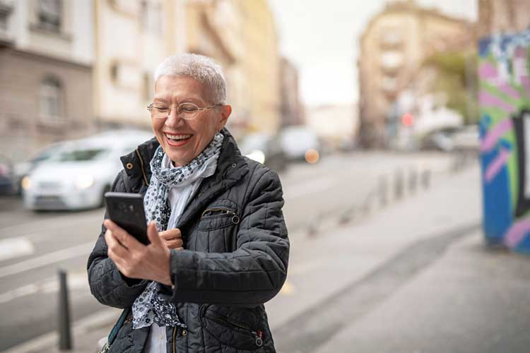 LGBTQI elder using smart phone to socialise