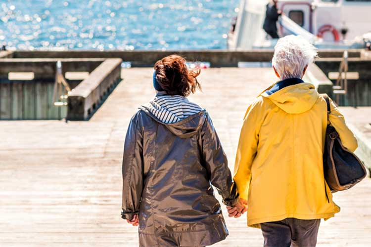 LGBTQI couple walking on pier feeling supported