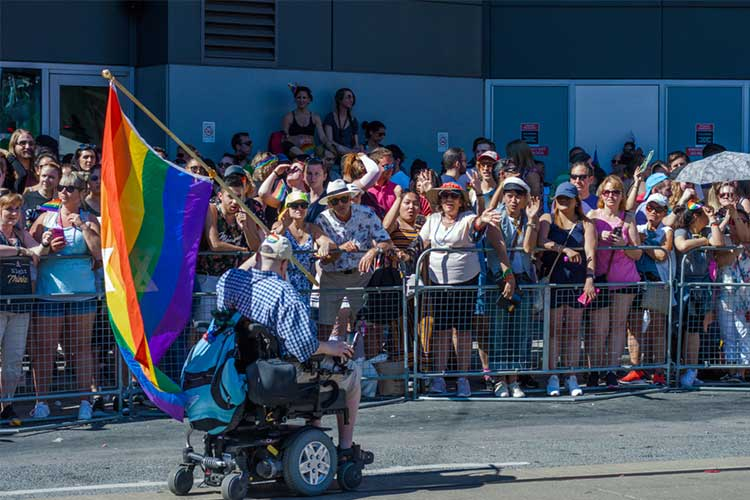 LGBTQI elder using wheelchair in pride parade