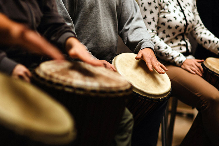 People playing the drums as group music therapy for dementia