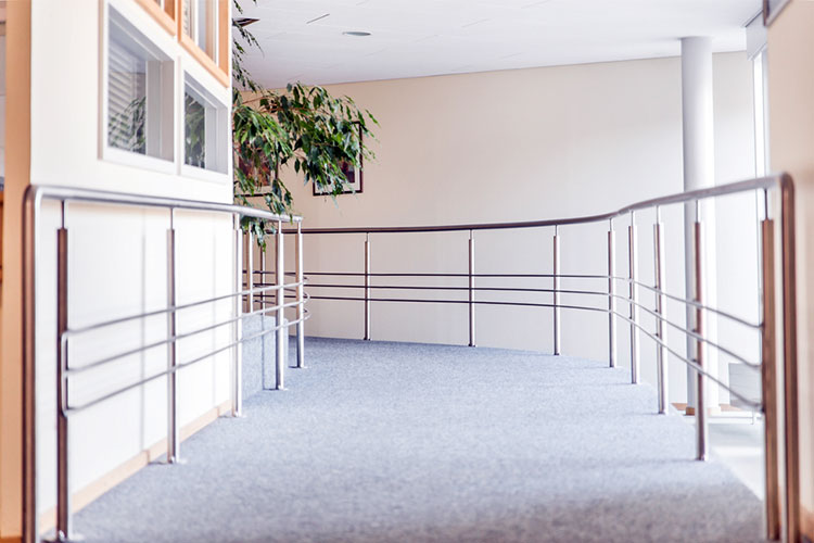 aged care facility hallway with rails for mobility assistance
