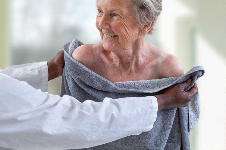 Elderly woman drying after shower | Image