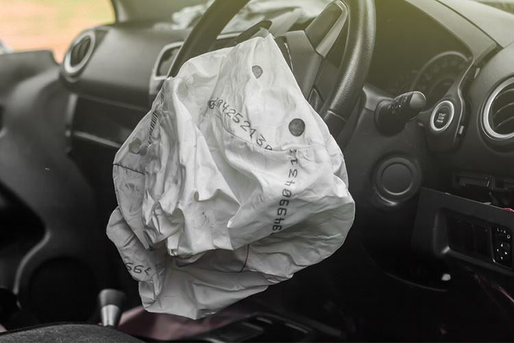 Airbag deployed in car example of traumatic event that may cause PTSD