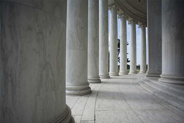 White building columns | Image
