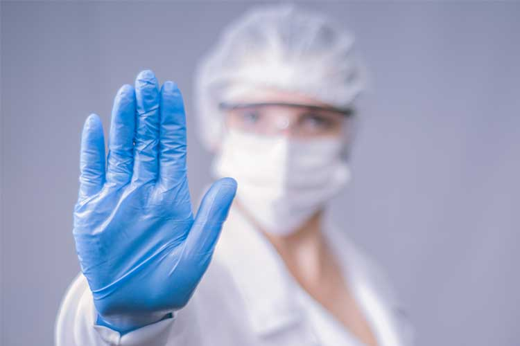 Healthcare professional wearing PPE | Image