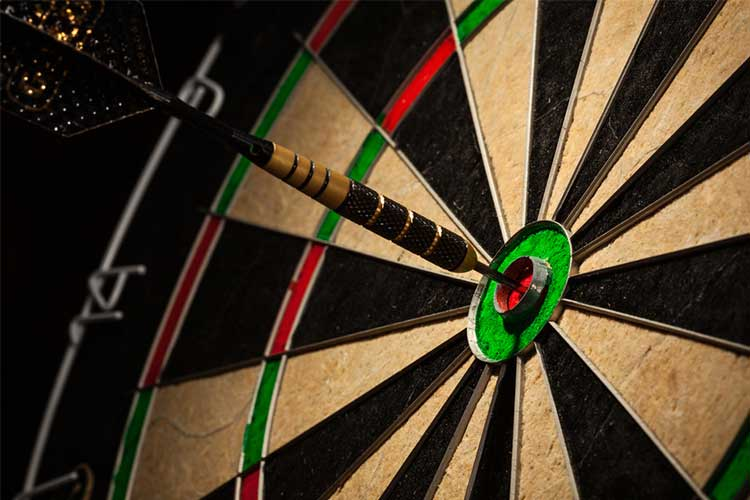 Dart in bullseye on dart board | Image