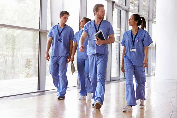 Nurses walking down hallways | Image
