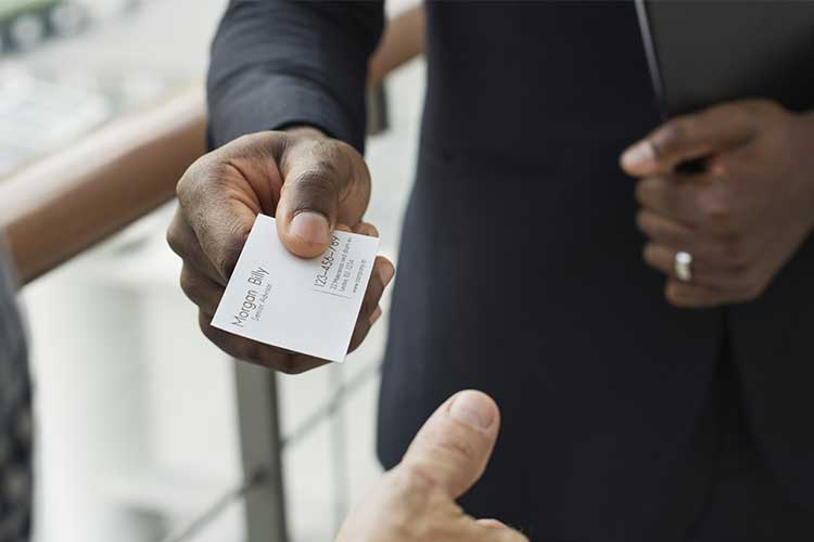 Person passing business card | Image
