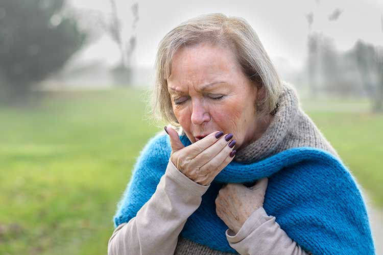 Elderly woman coughing | Image