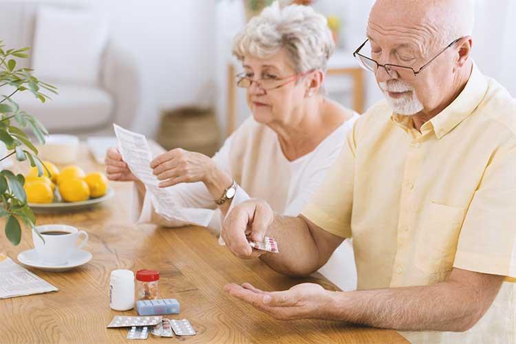 Elderly man preparing to take medication | Image