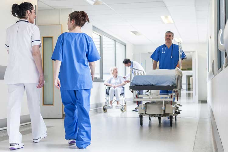 Hospital hallways populated with health professionals