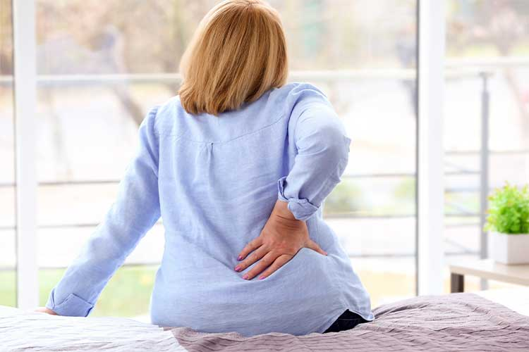 back pain symptom osteoporosis