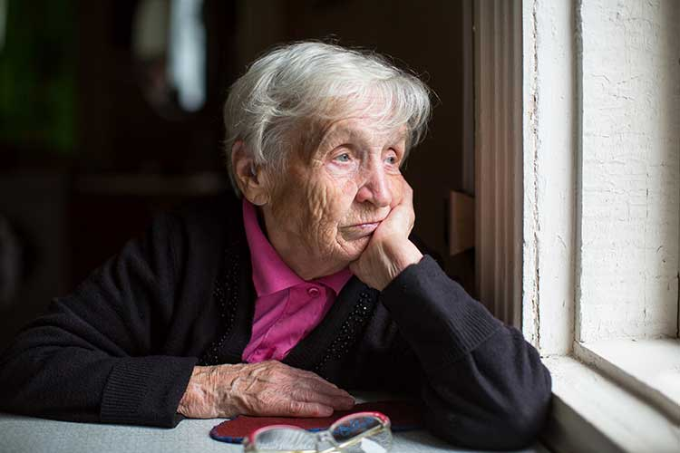 complex bowel care older woman isolated and sad
