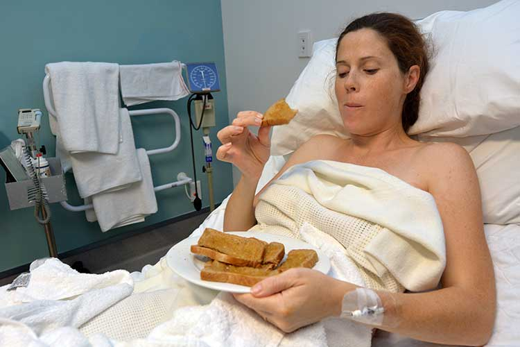 woman eating in hospital
