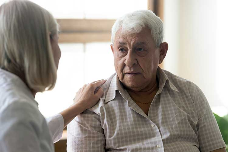 older man talking to nurse about sexual health concerns