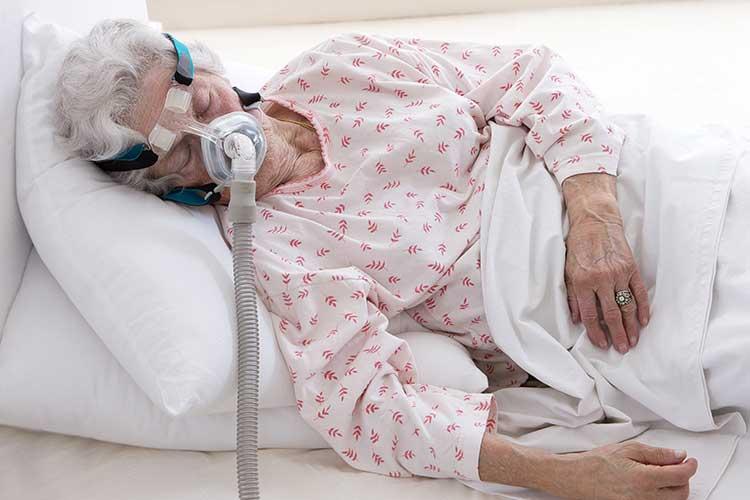 older woman sleeping while receiving niv