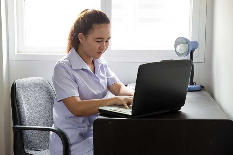nurse using laptop