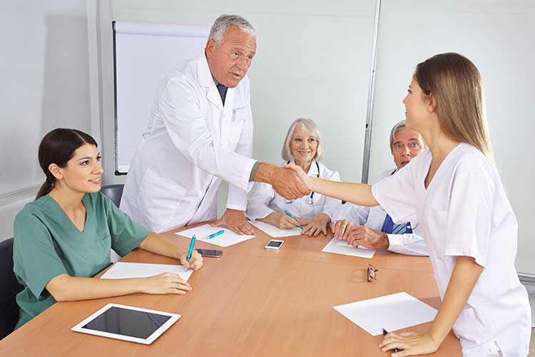 nurse shaking hands at new job