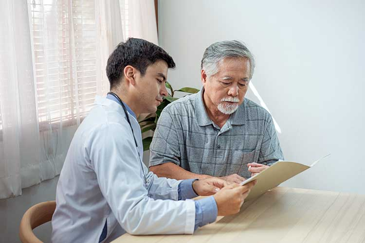 care staff explaining document to client
