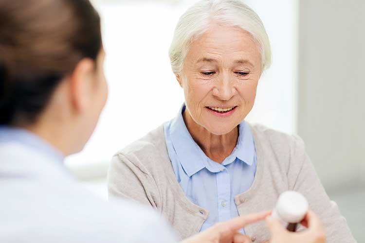 staff informing client about antibiotics