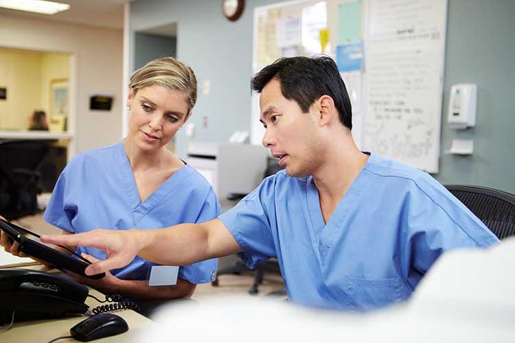 nurses discussing their practice