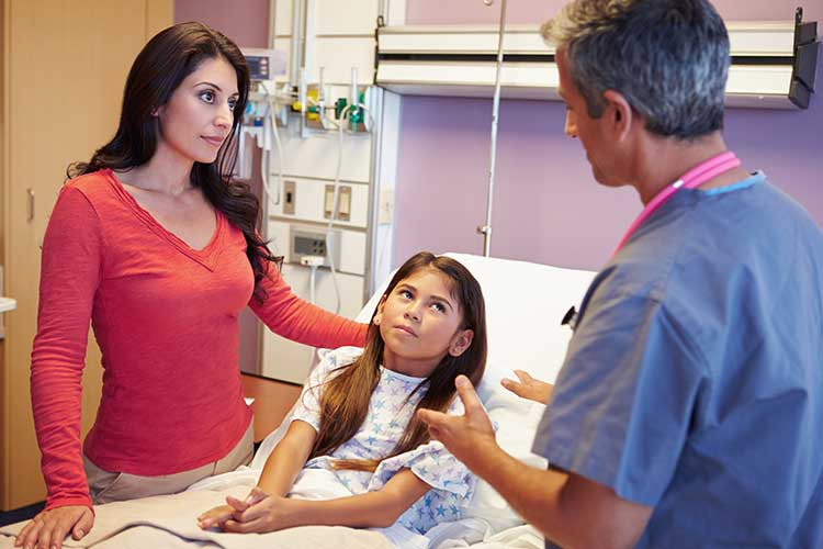 young child and mother talking to nurse about treatment options