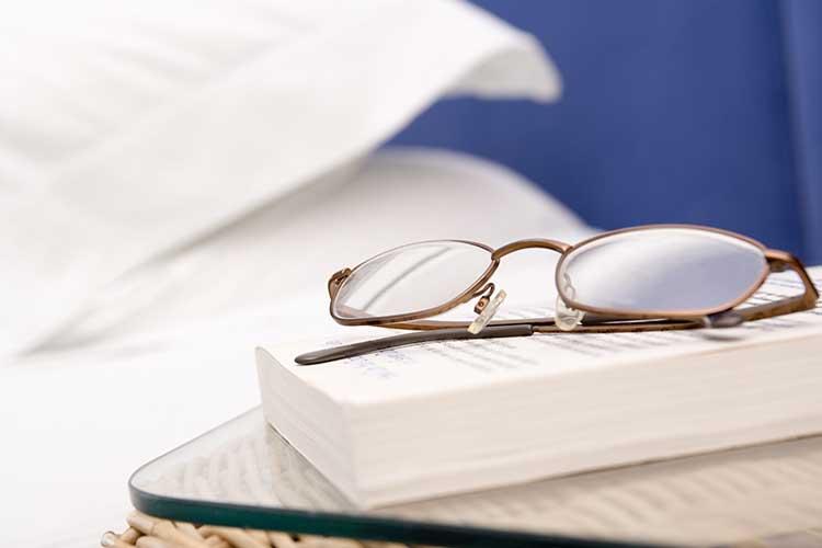 glasses on hospital bedside table