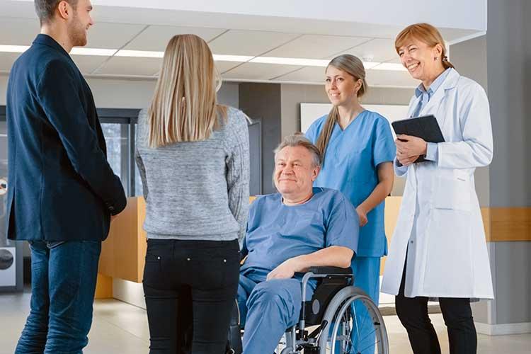 nurse talking to patient's family