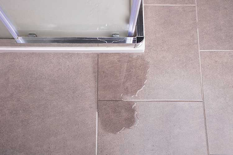 slipping hazard caused by leaking shower