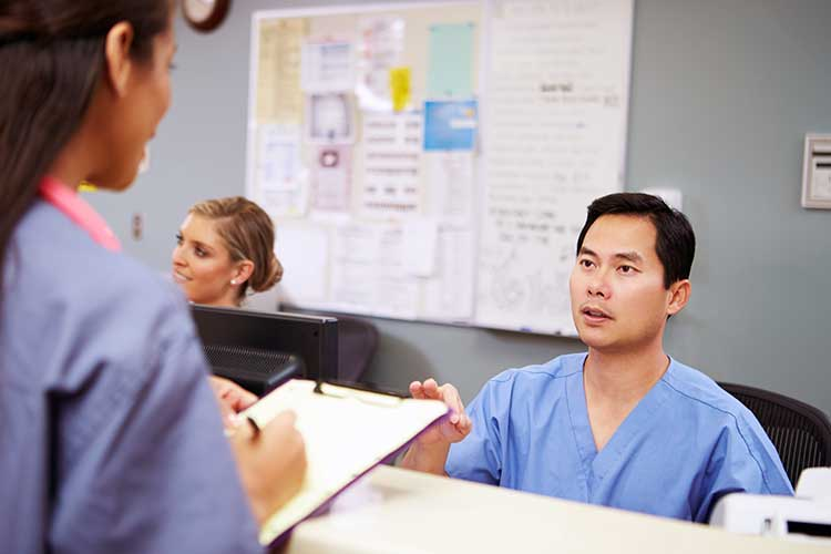 manager giving feedback to nurse