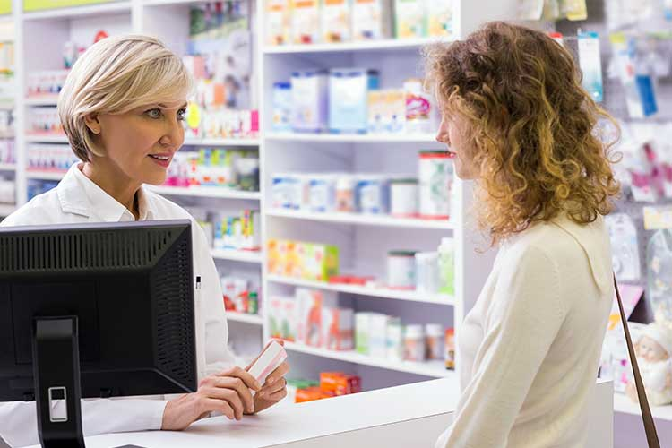 pharmacist helping client