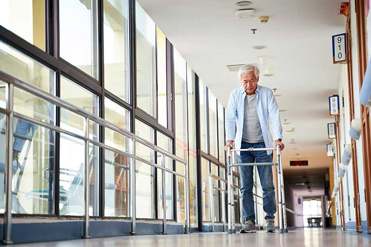 man using walking frame