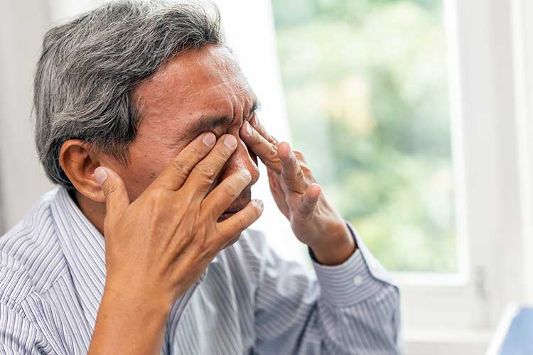 man experiencing eye strain from poor vision